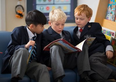 boys reading at the Sterling Hall School