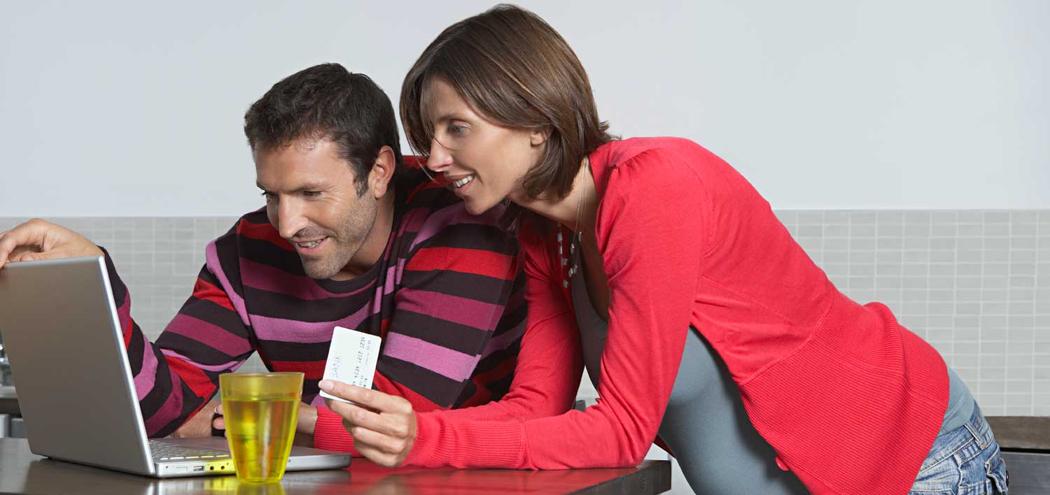 couple preparing to visit school open house events by viewing websites