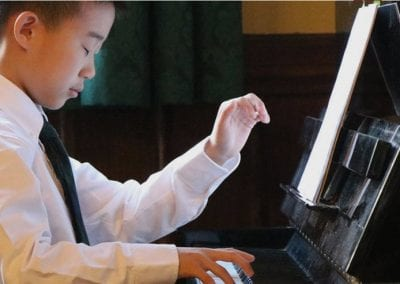 student playing the piano at Sacred Heart School of Halifax