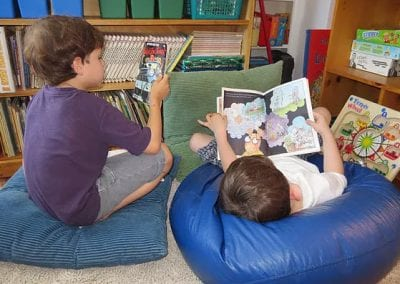 two boys reading together at the Dunblaine School