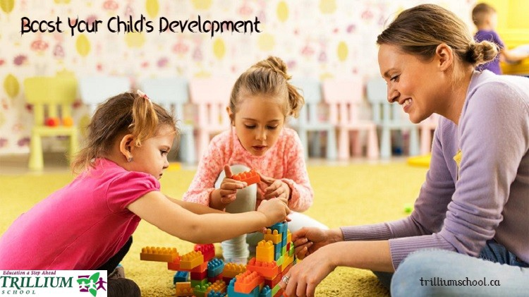 teacher and early childhood students building with lego