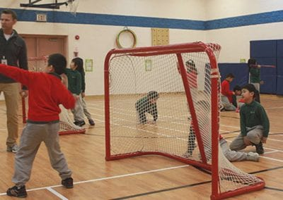 students playing in the gym at Trillium School