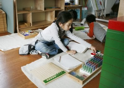 young girl working in class at Westside Montessori School