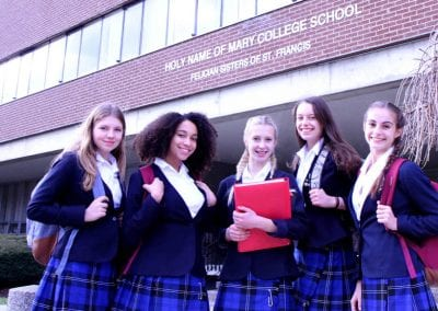 Senior student outside the entrance to Holy Name of Mary College School