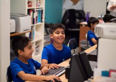 Junior school boys in computer class at Newton's Grove School