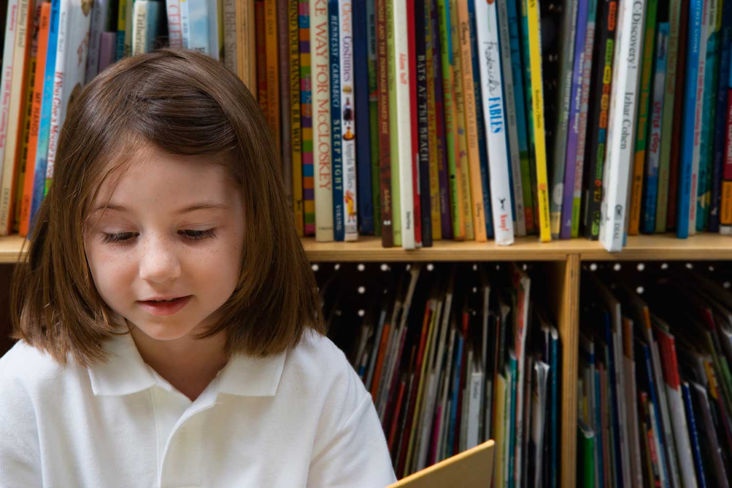 young girl reading in the library