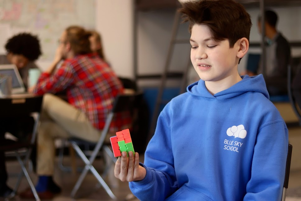 jay using rubik's cube at blue sky school