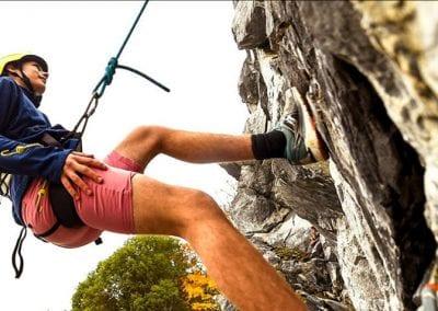 Shawnigan Lake Student climbing a rock face.